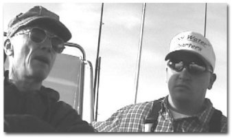 "Travis Williams on the right and the author on the left in Travis' slick boat, ""Cool Waters"" on their way to a good salmon fishing ground."