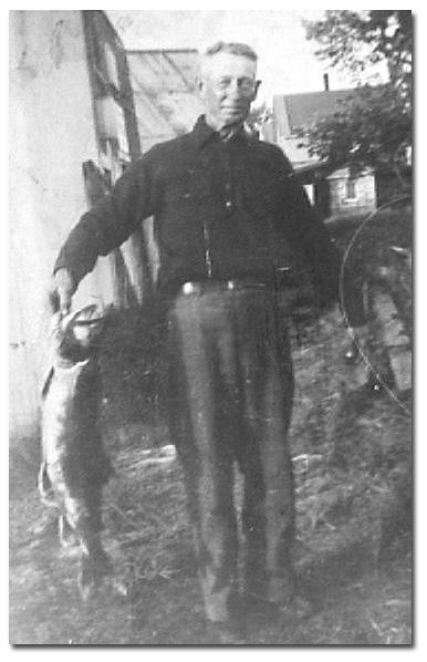 Bill Martel with a fefty Laker, circa 1935.