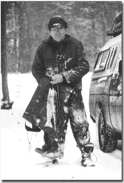A frozen Carl Gebhardt with two frozen salmon.