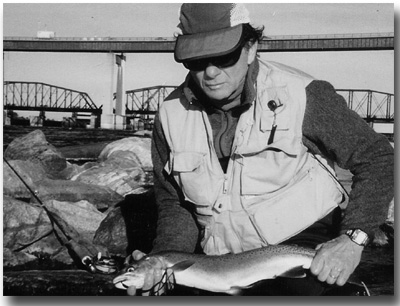 Carl Gephardt with big rainbow trout caught on a fly.