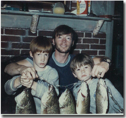 The author with sons Eric and Gregg iin 1970 with great string of bass. We don't catch as many big ones now that there are over 85 bass tournaments per summer on Lake Winni.