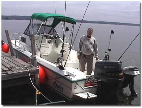 My Angler Fishing boat with 150 HP Suzuki, kicker, and new electric downriggers -- a fishing machine!