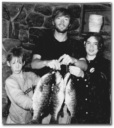 Eric and Rita in 1970 with father, holding small mouth bass.
