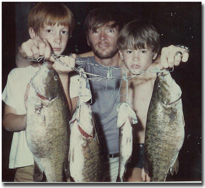 Sons, Eric & Gregg with father with very large bass!1969.