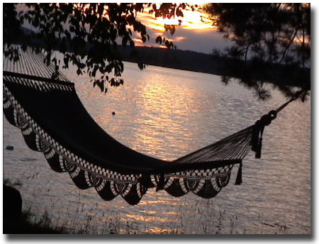Early morning sunrise though an angler's mid day resting place -- his hammock.