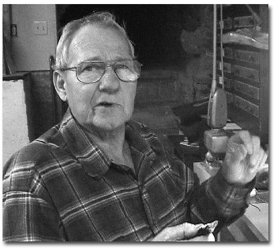 "Master angler and flytier, Jim Warner, works on tying his famous streamer creation the"" Lake Winni Smelt."""