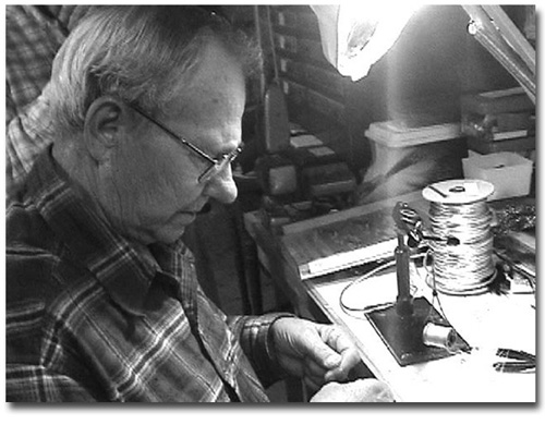Jim Warner doing the work he loves, tying flies.