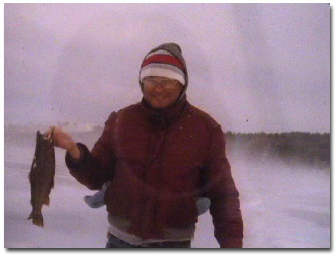 The late Paul Phillippe with a rainbow trout caught through the ice.