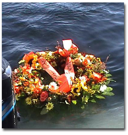 Wreath in Paul Phillippe's memory floating over his favorite fishing spot on Lake Winni.