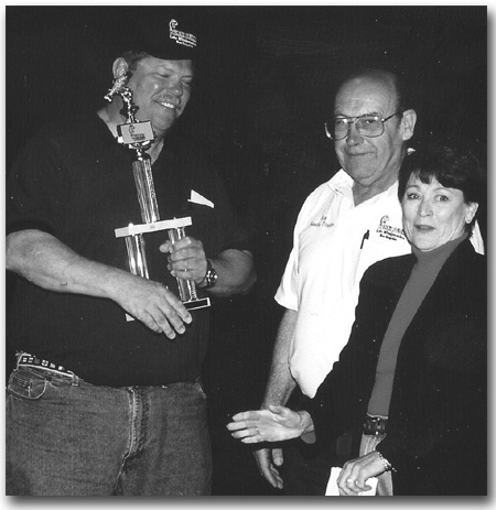Mr. & Mrs. Rick Davis awarding the Grand Prize trophy to the 2000 Derby winner.