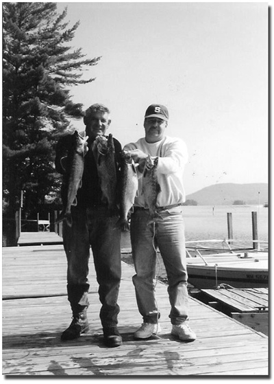 Steve and friend with nice catch of Lakers, salmon and rainbow trout.