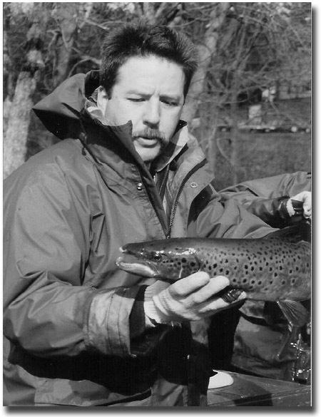 Master Angler Steve Perry with large male salmon in fall.