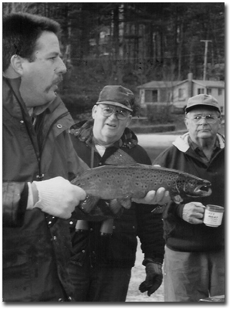 Steve Perry with large hooked jaw male salmon in fall.