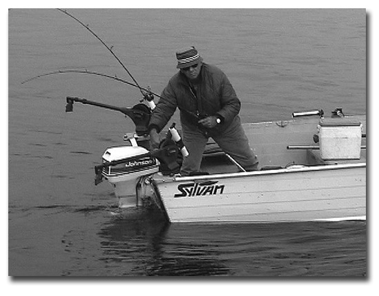 Ted St. Onge lowering his down rigger ball with Davis spinners attached and his live sewn shiner just above and behind it to 44 degrees where the salmon are and where he will soon catch one.