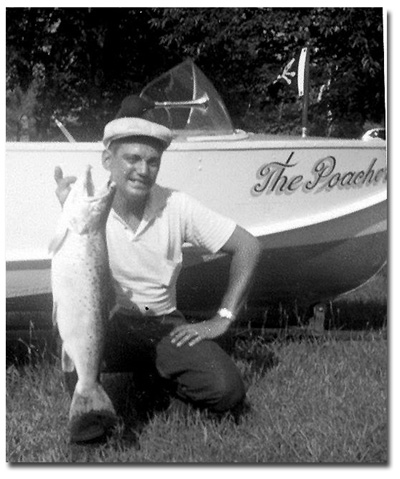 "A photo of Ted St. Onge with a 31"" 10lbs salmon in front of his boat, ""The Poacher."""