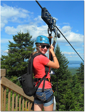 Zip lining at gunstock in new hampshire the larger people the cut off is around 120 lbs so its not really larger wear harnesses that fit over your shoulders gunstocks zip lining solutioingenieria Images